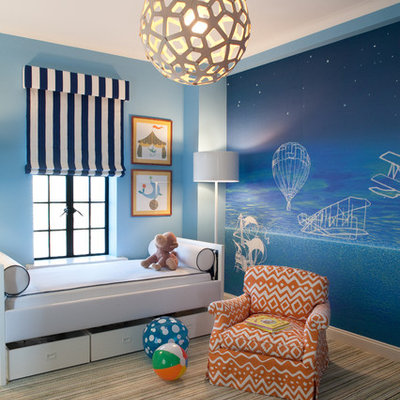 Kids' room - contemporary gender-neutral carpeted kids' room idea in New York with blue walls