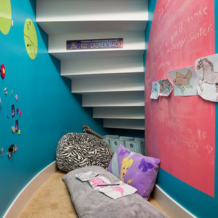Example of a small trendy girl carpeted kids' room design in Minneapolis with multicolored walls