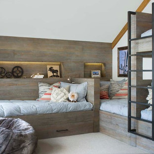 Example of a mountain style gender-neutral carpeted and beige floor kids' room design in Denver with white walls