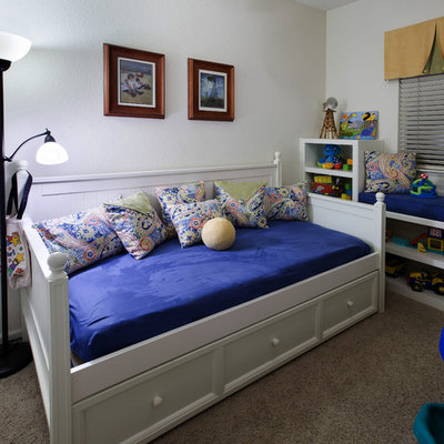 Inspiration for a mid-sized contemporary gender-neutral carpeted kids' room remodel in Sacramento with white walls