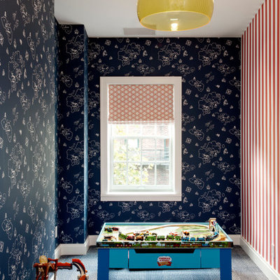 Example of a trendy boy carpeted playroom design in New York with multicolored walls