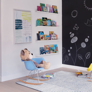 Inspiration for a contemporary gender-neutral light wood floor and beige floor kids' room remodel in New York with white walls
