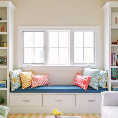 Inspiration for a mid-sized transitional gender-neutral playroom remodel in Chicago with beige walls