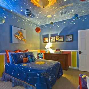 Idee per una cameretta per bambini da 4 a 10 anni contemporanea con pareti blu e moquette