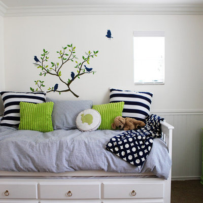 Eclectic gender-neutral carpeted kids' room photo in Orange County with white walls