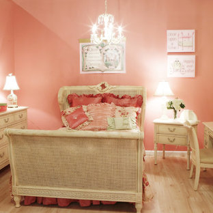 This is an example of a traditional kids' room for girls in New York with multi-coloured walls.