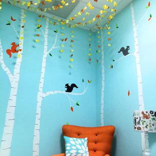 Foto de dormitorio infantil de 1 a 3 años, moderno, pequeño, con paredes azules y moqueta