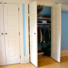 Traditional Closet by Home Restoration Services, Inc.