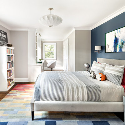 Transitional boy dark wood floor and brown floor kids' room photo in New York with blue walls