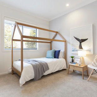 Inspiration for a beach style kids' room in Melbourne with grey walls, carpet and beige floor.