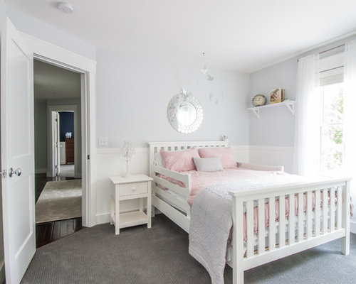 example of a classic carpeted and gray floor kids bedroom design in new york with - Traditional Kids Room Interior