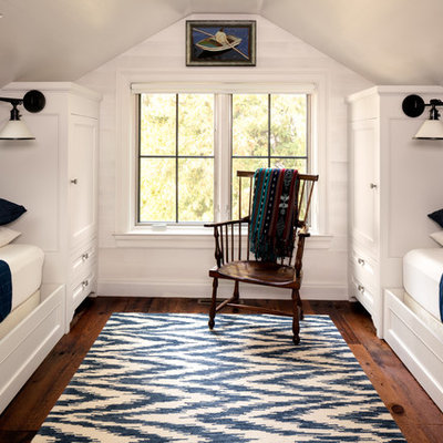 Inspiration for a small coastal gender-neutral dark wood floor kids' bedroom remodel in Milwaukee with white walls