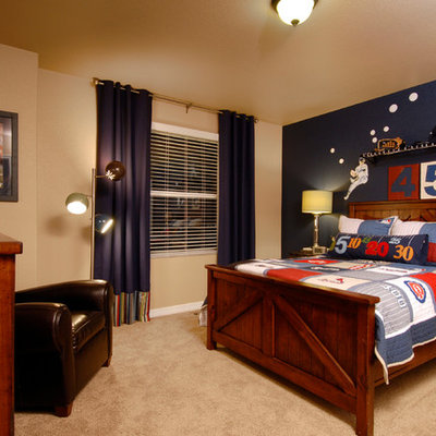 Example of a classic beige floor and carpeted kids' room design in Denver with multicolored walls