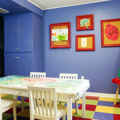 Example of a classic gender-neutral multicolored floor kids' room design in Minneapolis with purple walls