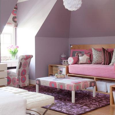 Kids' room - large traditional girl light wood floor kids' room idea in Little Rock with purple walls
