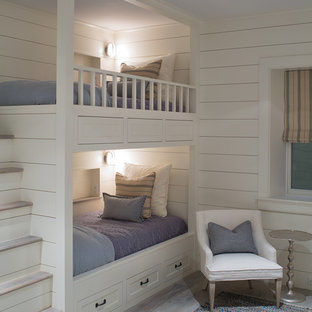 Example of a mid-sized transitional gender-neutral kids' bedroom design in Boston with white walls