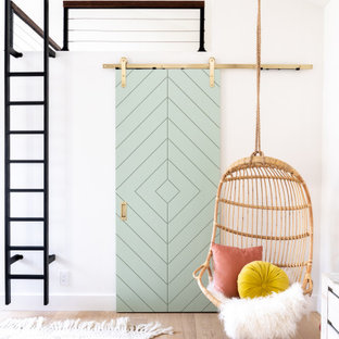 Mid-sized trendy girl light wood floor and beige floor kids' room photo in Orange County with white walls