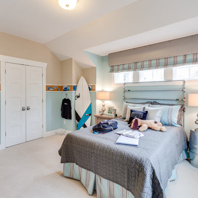 Inspiration for a coastal boy carpeted kids' room remodel in Other with multicolored walls