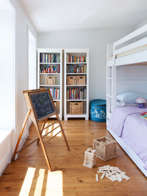 Bookshelves With Baskets Part - 18: Inspiration For A Mid-sized Contemporary Gender-neutral Medium Tone Wood  Floor And Beige