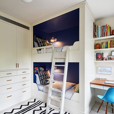 Mid-sized transitional gender-neutral carpeted kids' room photo in New York with blue walls