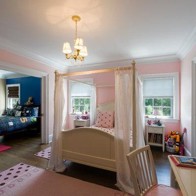 Large elegant girl dark wood floor kids' room photo in New York with pink walls