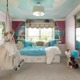Inspiration for a transitional girl carpeted and gray floor kids' room remodel in Minneapolis with pink walls