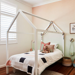 This is an example of a contemporary kids' room in Sydney with green walls, medium hardwood floors and brown floor.