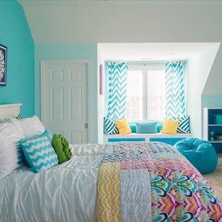 Photo of a large classic teen's room for girls in New York with blue walls, carpet and beige floors.