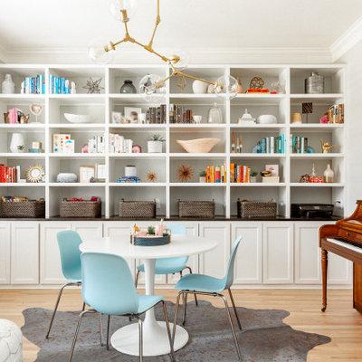 Transitional gender-neutral medium tone wood floor and brown floor kids' room photo in Dallas with beige walls