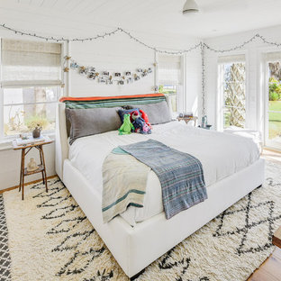 Inspiration for a contemporary girl light wood floor kids' room remodel in Jacksonville with white walls