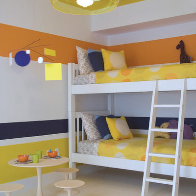 Example of a trendy gender-neutral kids' room design in Miami with multicolored walls