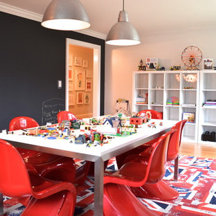 Kids' room - contemporary gender-neutral kids' room idea in New York with black walls
