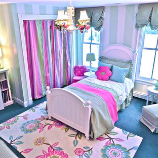 Kids' bedroom - contemporary girl carpeted kids' bedroom idea in Boston with multicolored walls
