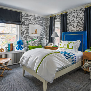 Trendy boy carpeted and gray floor kids' bedroom photo in Boston with multicolored walls