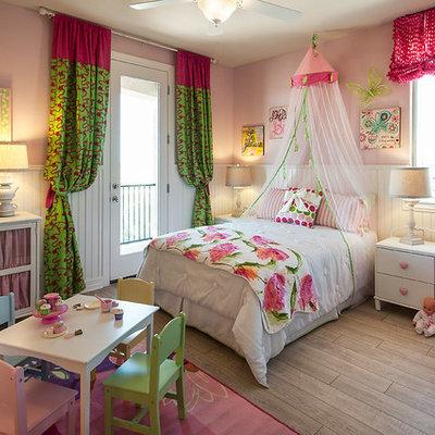 Kids' bedroom - contemporary kids' bedroom idea in Phoenix with pink walls