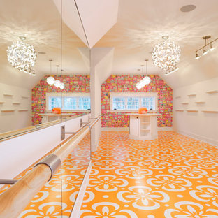 Example of a trendy girl orange floor playroom design in Minneapolis with white walls