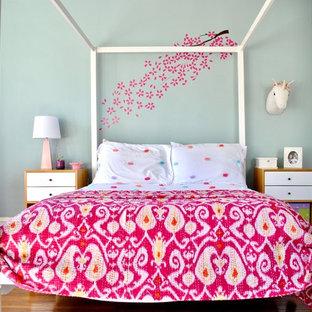 Trendy medium tone wood floor and brown floor kids' bedroom photo in Philadelphia with blue walls