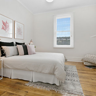 Inspiration for a contemporary teen room for girls in Hobart with red walls and medium hardwood floors.