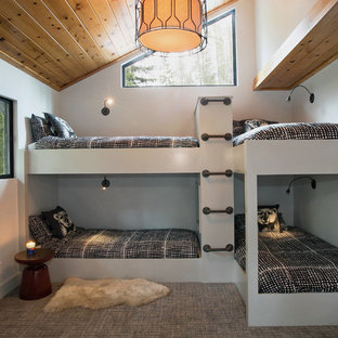 Mid-sized trendy gender-neutral carpeted kids' room photo in San Francisco with white walls