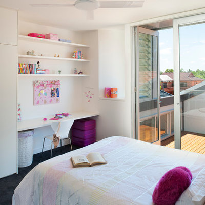 Kids' room - contemporary girl kids' room idea in New York with white walls