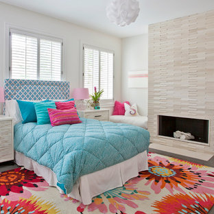 Contemporary kids' room in Chicago with white walls and medium hardwood floors for girls.