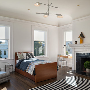 Kids' room - contemporary boy dark wood floor kids' room idea in San Francisco with white walls