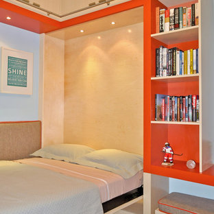 Kids' room - contemporary gender-neutral carpeted kids' room idea in New York with multicolored walls