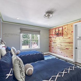Photo of a medium sized classic teen's room for boys in DC Metro with grey walls, medium hardwood flooring and brown floors.