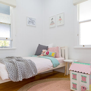 Design ideas for a contemporary kids' room for kids 4-10 years old and girls in Other with white walls, medium hardwood floors and beige floor.