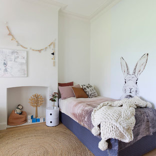Design ideas for a large country kids' bedroom for kids 4-10 years old and girls in Wollongong with white walls, light hardwood floors and beige floor.