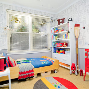 Design ideas for a mid-sized contemporary gender-neutral kids' room for kids 4-10 years old in Los Angeles with grey walls and carpet.