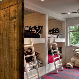 Example of a mountain style kids' room design in Minneapolis with white walls