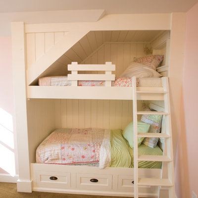 Small elegant girl carpeted kids' room photo in Minneapolis with pink walls