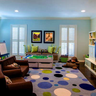 Example of a large classic boy dark wood floor and brown floor kids' room design in Tampa with blue walls